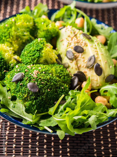 Green plant based salad with broccoli and avocado