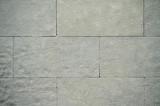 Background of a large rectangular tiles facade. Neutral grey texture