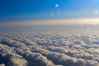sky with fluffy clouds, the view from the plane, flying on an airplane - 239959823