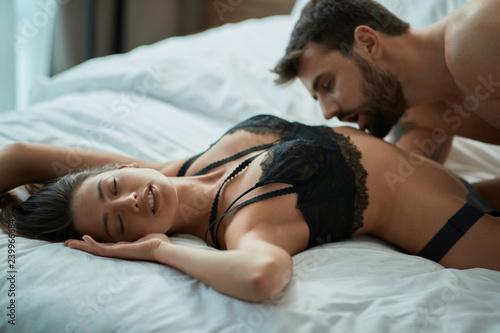 Leinwandbild Motiv passionate lovers making love in hotel.