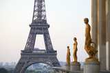 PARIS, FRANCE - JULY 7, 2018: Eiffel tower and golden staues, early morning in Paris, France © andersphoto