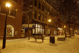 The streets of the night winter city during a snowfall. Portland. USA. Maine.