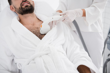 Close up of man undergoing laser hair removal