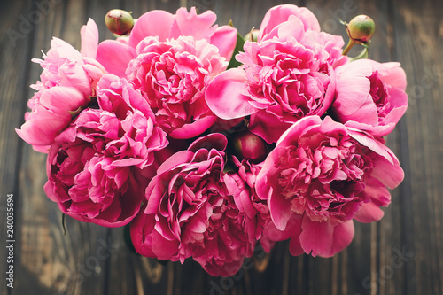 pink peonies bouquet on rustic dark wooden background, top view, space for text. floral greeting card mock-up, flat lay. happy mothers day concept. pink flowers, floral image - 240035694