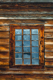 window in the log wall of an old building