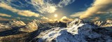 Beautiful panorama of mountain peaks in the snow at sunset, sunrise over the mountains,