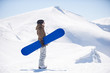 snowboarder with a board in the mountains
