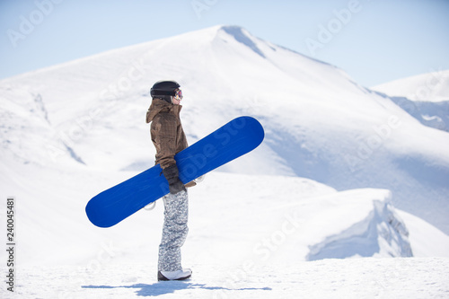 obraz lub plakat snowboarder with a board in the mountains
