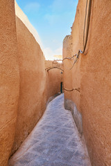 The narrow backstreet in Yazd, Iran © efesenko
