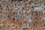 Brick wall texture background with red damaged old surface and white paint spots