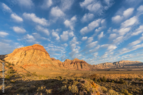 Early morning light with partly cloudy sky at Red Rock Canyon National Conservation Area.  A popular natural area 20 miles from Las Vegas, Nevada.