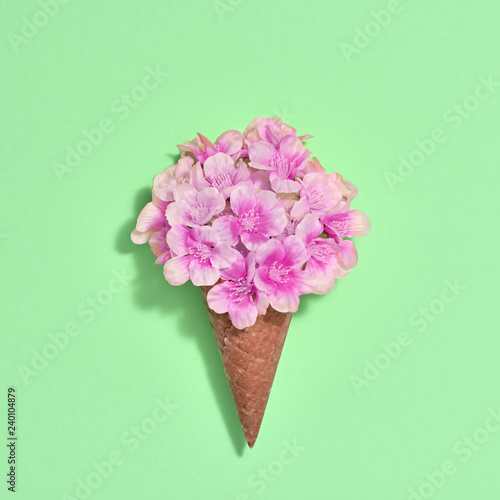 Leinwanddruck Bild Bouquet of Flowers in Ice Cream Cone. Trendy fashion Style. Spring Summer Floral concept. Creative Minimal. Pink Blossom on green, Art