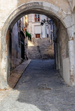 Lisbon - Portugal, access by a stone arch to the famous Alfama district © gpriccardi