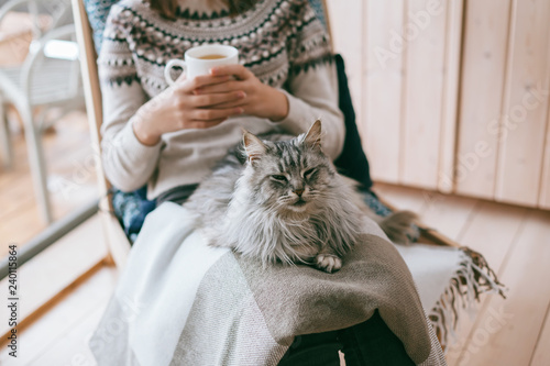 Girl relaxing with cat at home