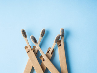 Bamboo biodegradable toothbrushes on blue © tenkende