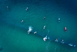 Aerial view of a group of surfers in the ocean at the Baleal beach in Peniche, Portugal - 240177451