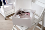 White opened box with folded pink dress - 240202092