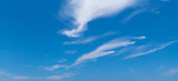 Blue sky with windy cirrus clouds at daytime © eugenesergeev
