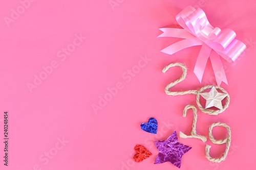 Happy New Year 2019 on pink wooden background - 240248454