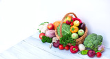 Farm products - basket of vegetables on blue wooden background. - 240256033