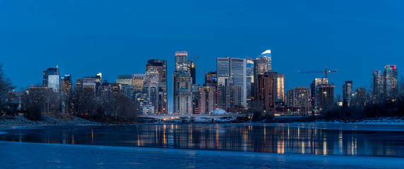 Calgary's skyline along the Bow River in winter. © Jeff Whyte
