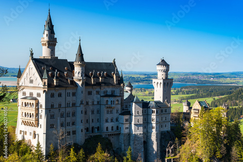 Leinwanddruck Bild Beautiful view of world-famous Neuschwanstein Castle, the 19th century Romanesque Revival palace built for King Ludwig II, with scenic mountain landscape near Fussen, southwest Bavaria, Germany