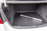Plastic baseball bat in the luggage compartment of a car, self-defense concept - 240282029