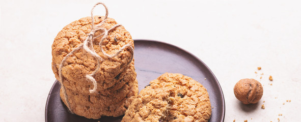 Stack of oatmeal cookies on white wooden background Homemade bakery Healthy food snack concept Gorisontal banner © lizaelesina