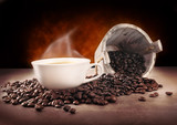 Cup of  hot coffee and coffee beans on  brow background