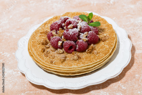 traditional thin pancakes with fresh raspberries