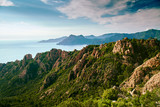 View of Calanques de Piana in Corsica from above with sea in the background