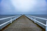 wooden pier on winter sea
