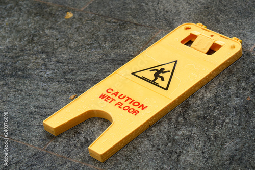 Caution Wet Floor Sign Laying On The Pavement