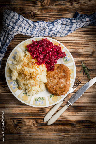 Pork cutlet with minced meat served with boiled potatoes and beetroot. - 240387046
