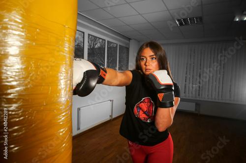 Girl make boxing workout yellow boxing bag