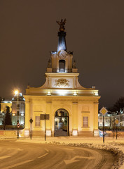 Branicki Palace in Bialystok in Poland at night in winter scenery. The entrance gate to the palace.
