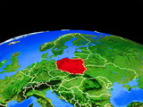 Poland on model of planet Earth with country borders and very detailed planet surface.