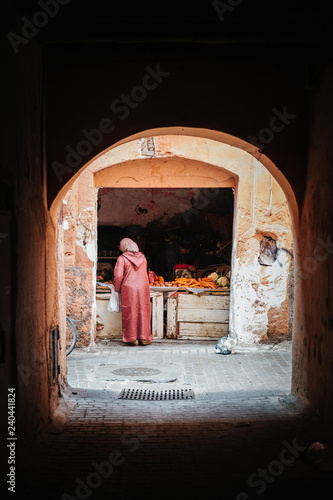 woman buying vegetables in Marrakesh, Morocco
