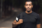 Muscular african-american man posing outside after workout - 240458848