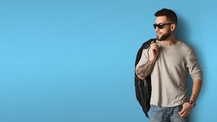Handsome stylish man posing in studio
