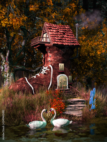 Two swans and fairytale house - 240462482