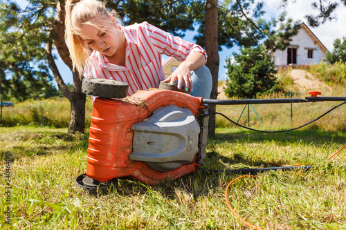 Person having problem with land mower