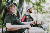 Joyful elderly man enjoying his fishing weekend