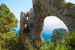 Quadro Arco Naturale, natural arch on coast of Capri island, Italy.