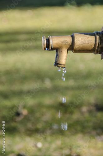 water drops falling in a public tap