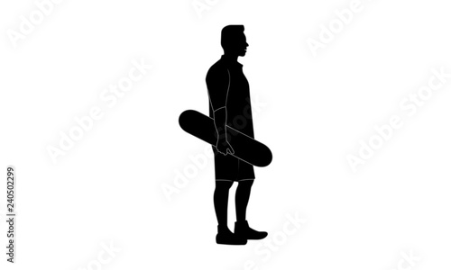 silhouette image of a man walking with a skateboard with his right hand.