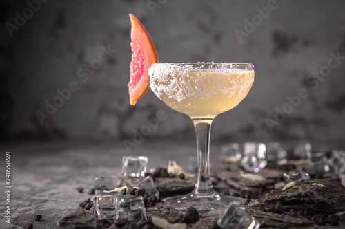 Alcoholic or non-alcoholic cocktail with lemon citrus and ginger with added liqueur, vodka, champagne or martini. Cool drink. Easy Bartenders Recipes and Ideas