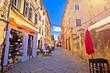 Leinwanddruck Bild - Sunny colorful stone street of ancient Pula view