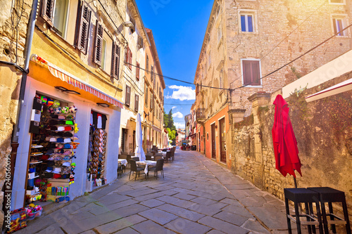 Leinwanddruck Bild Sunny colorful stone street of ancient Pula view