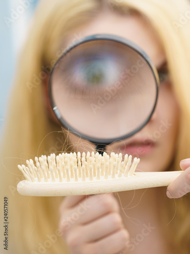 Woman magnifying hair brush